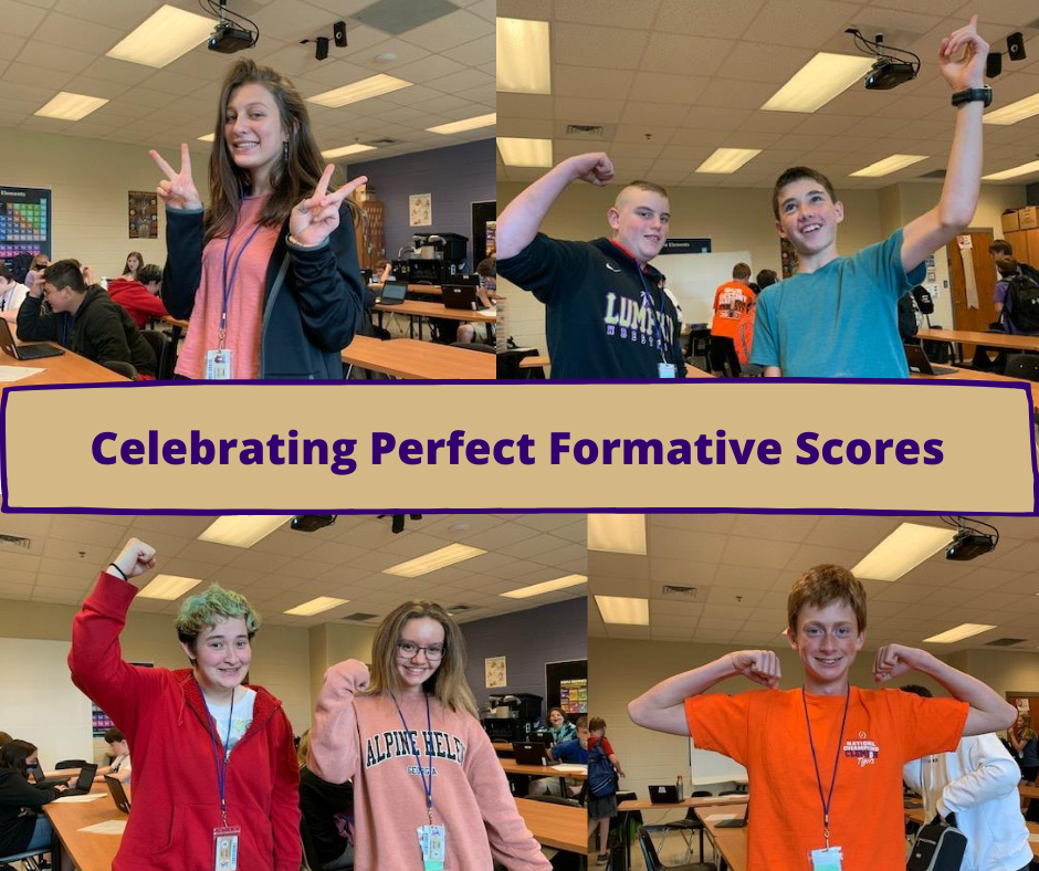 Students celebrating their perfect scores.